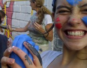 After a couple of hours the children were transformed into Smurfs. By Alfred Pasifico.
